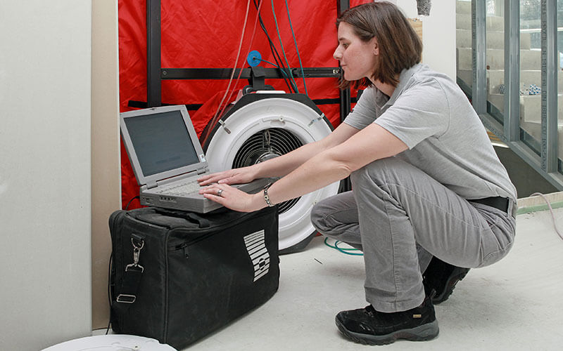 Energy advisor performing a blower door test